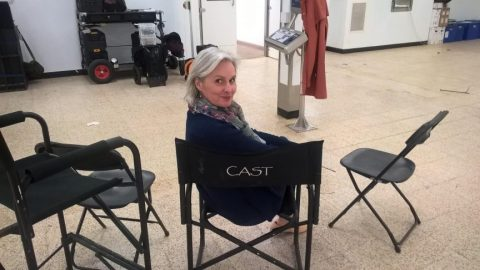 Supporting Artist in the cast chair on set